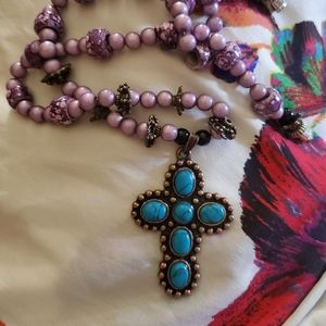 Turquoise an antique gold cross on a purple beaded